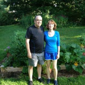 Scott and I by our garden in the summer of 2013, about 7 months plantstrong