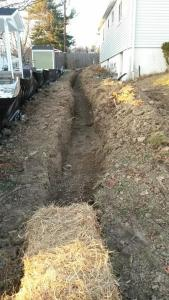 Ditch by house